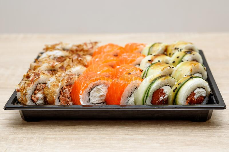 Home delivery of sushi set in a plastic box.  stock images