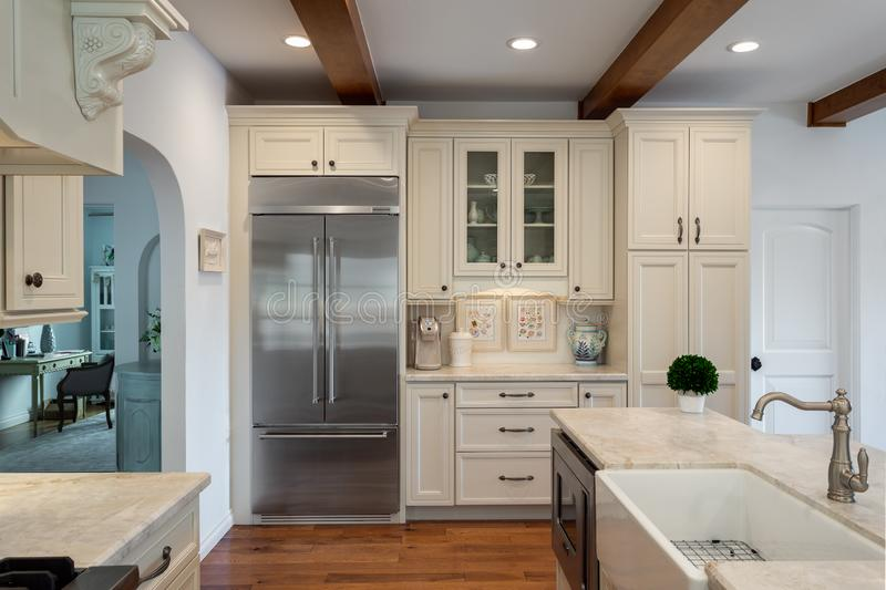 Home design remodel contemporary kitchen with farmhouse sink. Wood beams royalty free stock images