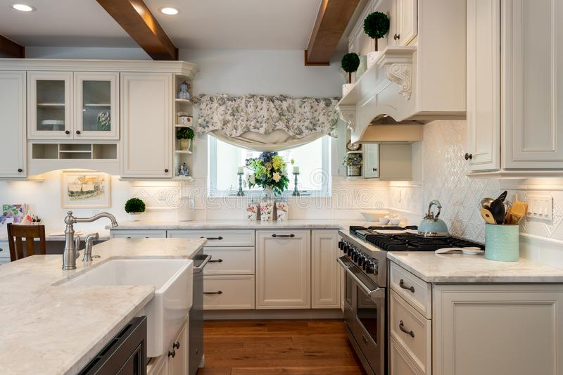 Home design remodel contemporary kitchen with two farmhouse sinks. Wood beams stock photography