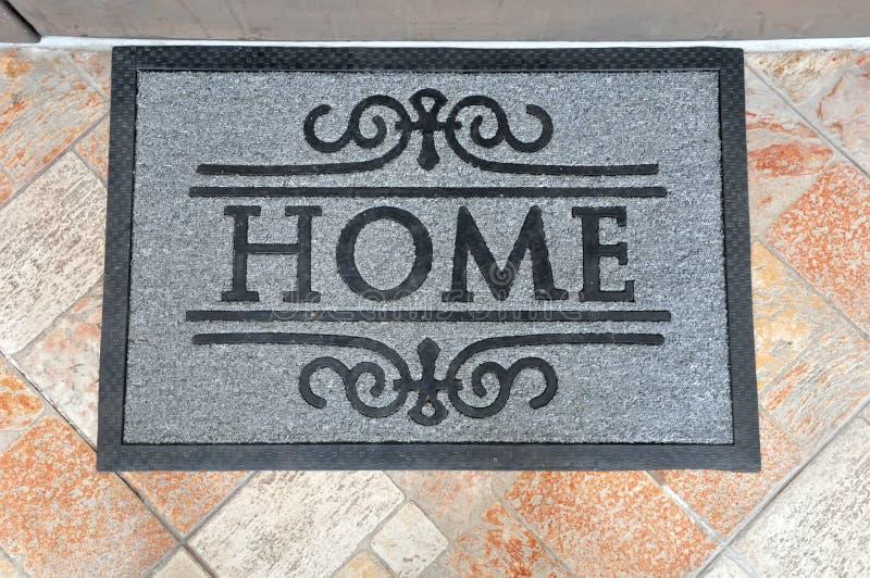 Home door mat. Beautiful grey home door mat royalty free stock photos