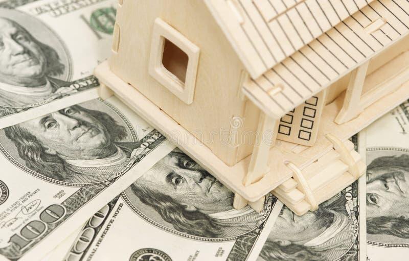 HOME e dinheiro imagens de stock