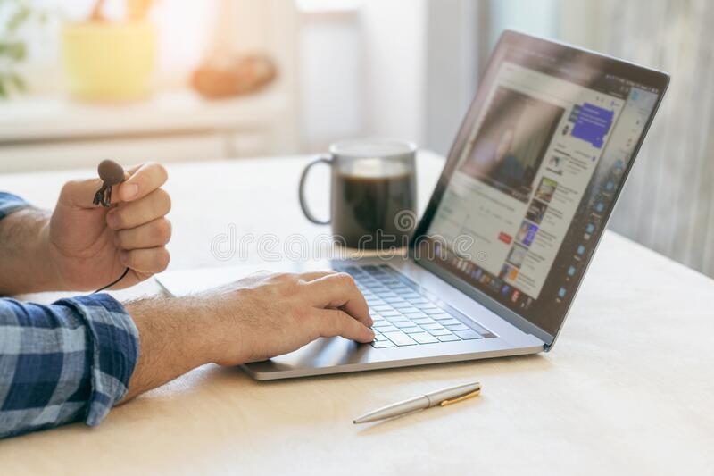 Home education, online training or work outside office concept. Man sit at desk look at pc screen live streaming teacher or coa. Home education, online training royalty free stock image