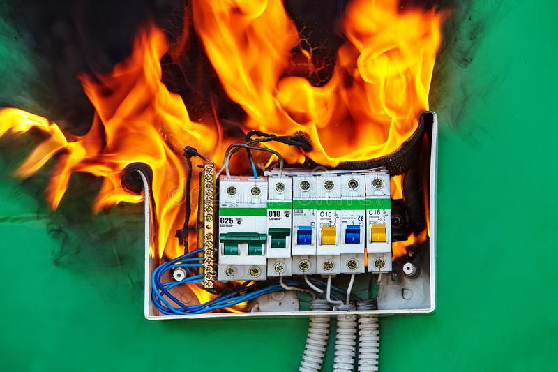 Home electrical fire started in distribution board. Defect of electrical distribution panel with circuit breaker is the cause of a fire in the apartment royalty free stock photos