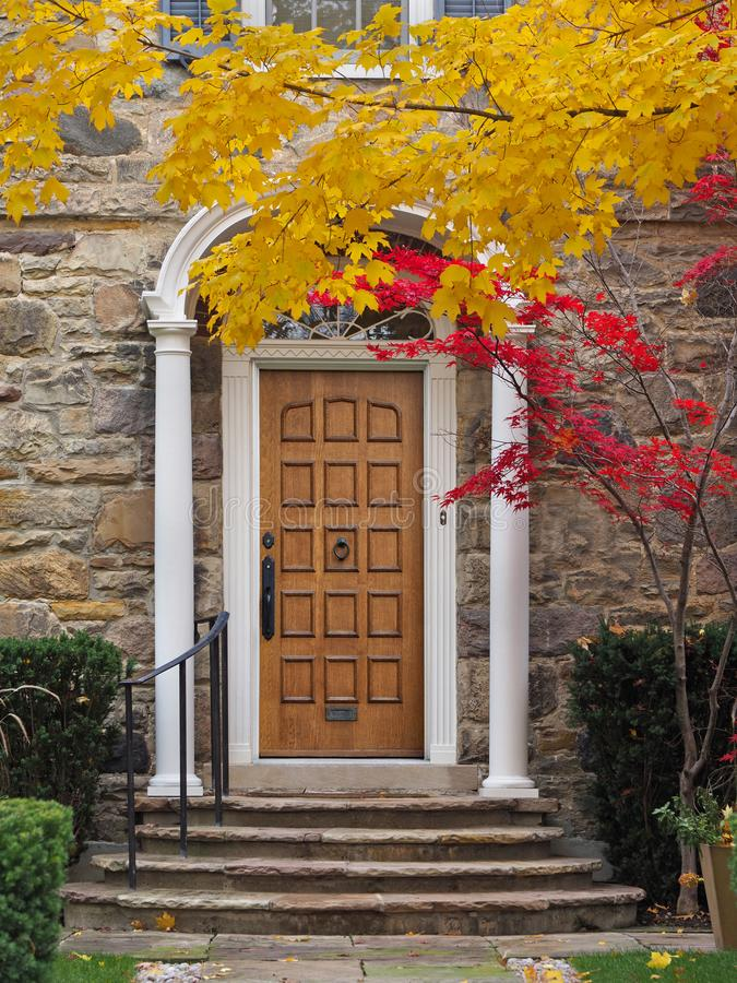 Home with elegant portico entrance and fall colors stock photos