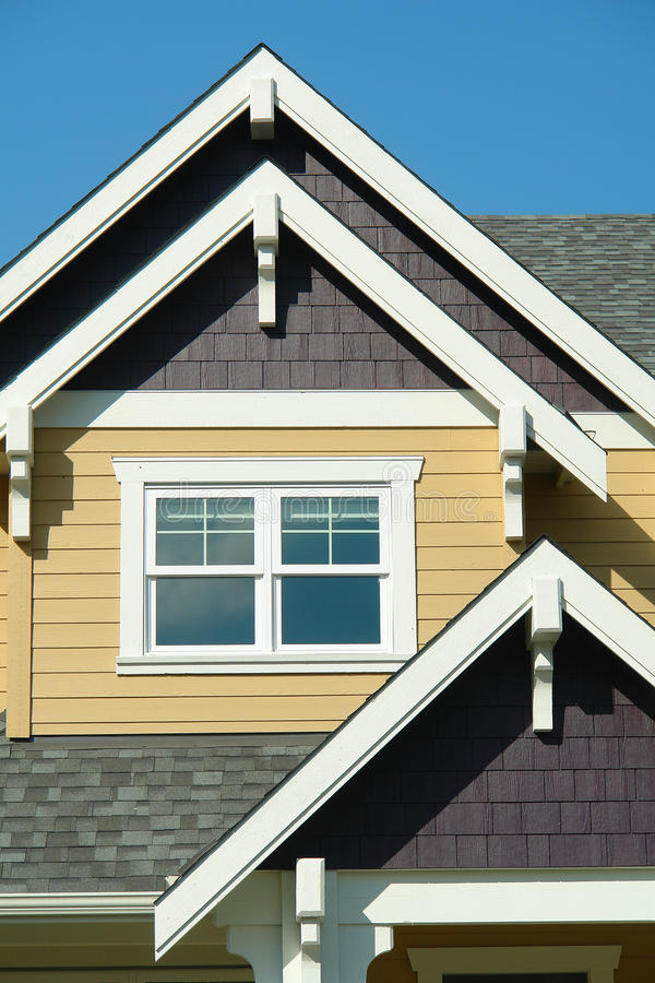 Home Exterior Gables. Colorful home exterior with end gable details royalty free stock images