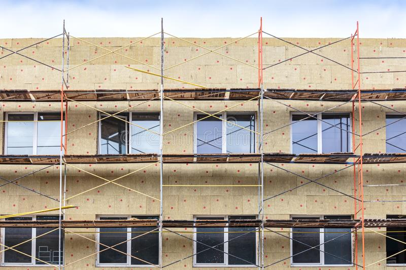 Home facade insulation with rock wool. energy efficiency house wall renovation stock photos