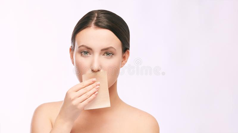 Home face care. Girl remove makeup. Woman hand with pad. Skin clean with paper royalty free stock photography