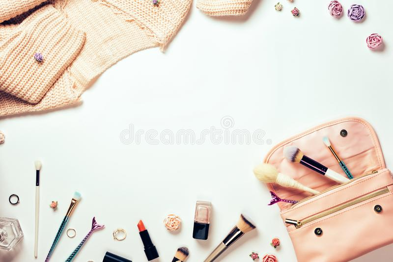 Home female workspace with a pink cardigan, a makeup bag royalty free stock image