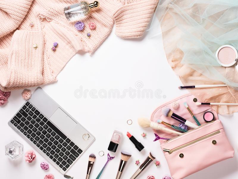 Home female workspace with a pink cardigan, shoes, dress stock image
