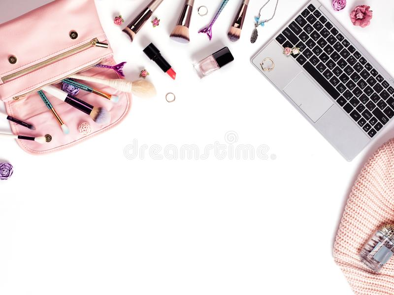 Home female workspace with a pink cardigan, shoes, dress royalty free stock photos