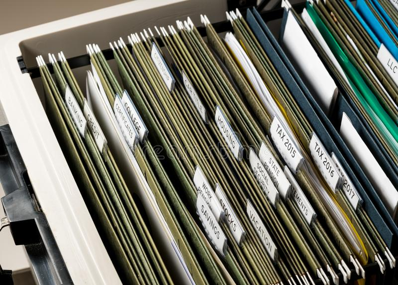 Home filing system for Social Security organized in folders. Close up of a well organized home filing system with tabs for each subject royalty free stock photo