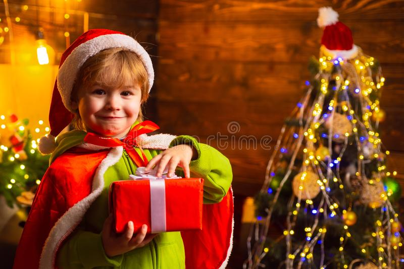 Home filled with joy and love. Merry christmas and happy new year. Family day christmas. Gifts and surprises. Cute. Little child boy play near christmas tree stock images