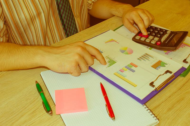 Home finances, investment, economy, saving money or insurance concept. Male working with calculator and document. Home finances, investment, economy, saving stock photos