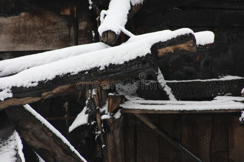 Home fire insurance. snow and a burnt stock photos