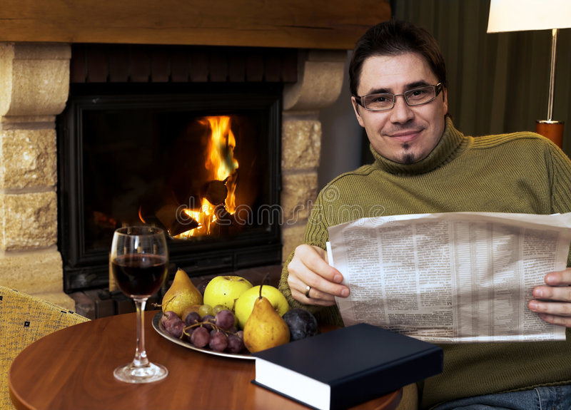 Download At home by the fireplace stock photo. Image of relaxing - 1719344