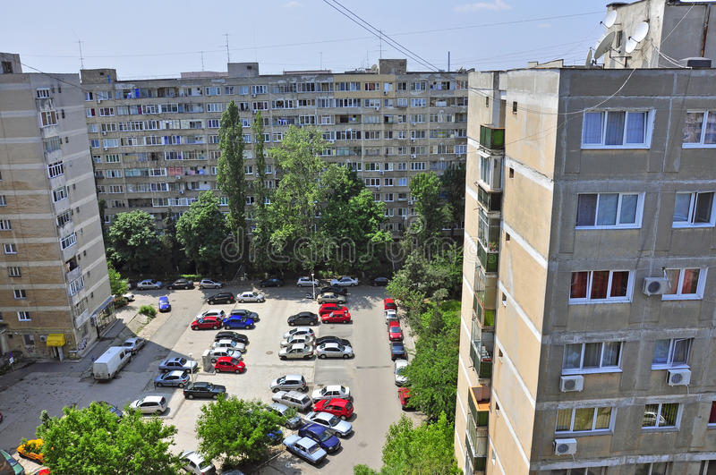Home flats. Block of flats and parking place in bucharest (romania) specific to former communist countries from eastern europe royalty free stock photo