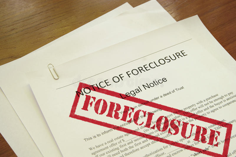 Home foreclosure. Mortgage foreclosure document with red stamped text royalty free stock images