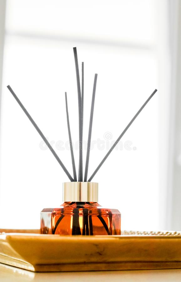 Home fragrance bottle, european luxury house decor and interior design details. Air freshener, reed diffuser and aromatherapy concept - Home fragrance bottle royalty free stock images