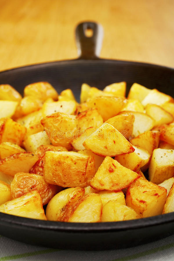 Home Fries Saute Potatoes Skillet. Home fries or saute potatoes in a black cast iron skillet stock photography