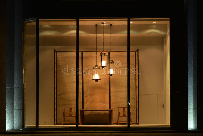 Home Furnishing shop display window with led chandelier Table Chair and Screen,Commercial space design. LED lighting in commercial display applications royalty free stock image
