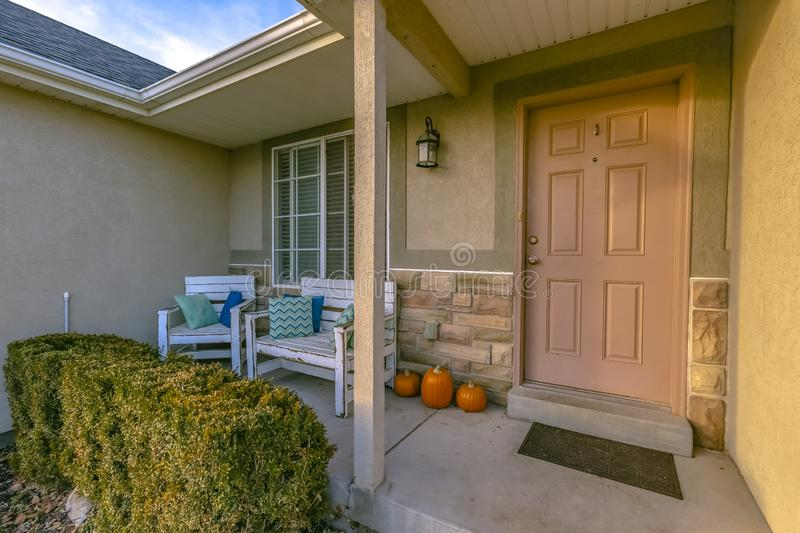 Home with furniture and pumpkins on front porch royalty free stock photos