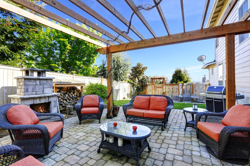 Home garden with patio area and fireplace stock image