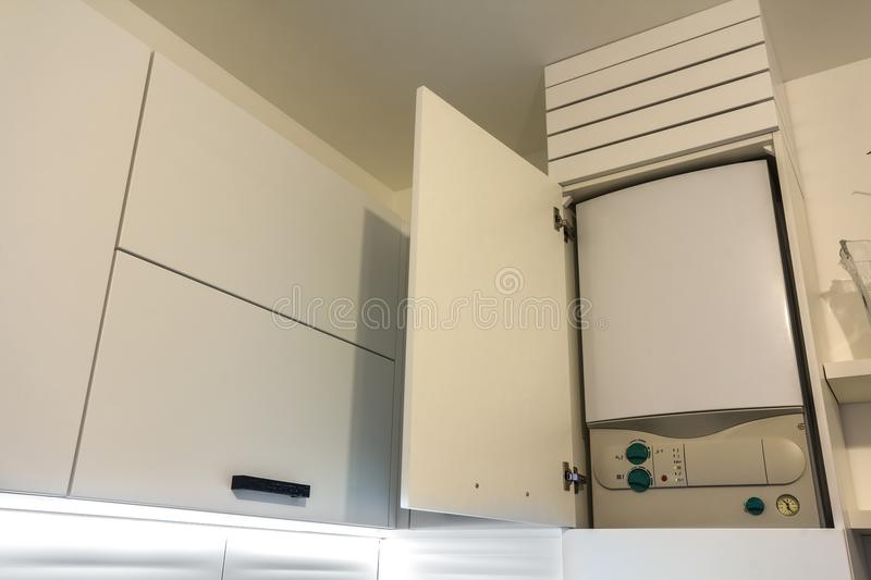 Home gas water heater boiler in kitchen furniture for apartment of home heating. stock image
