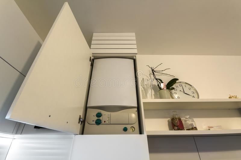 Home gas water heater boiler in kitchen furniture for apartment of home heating. stock photo