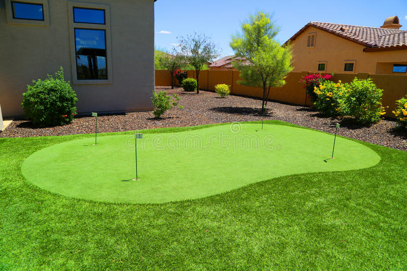 Home golfing green. Home miniature practice golfing green royalty free stock photo