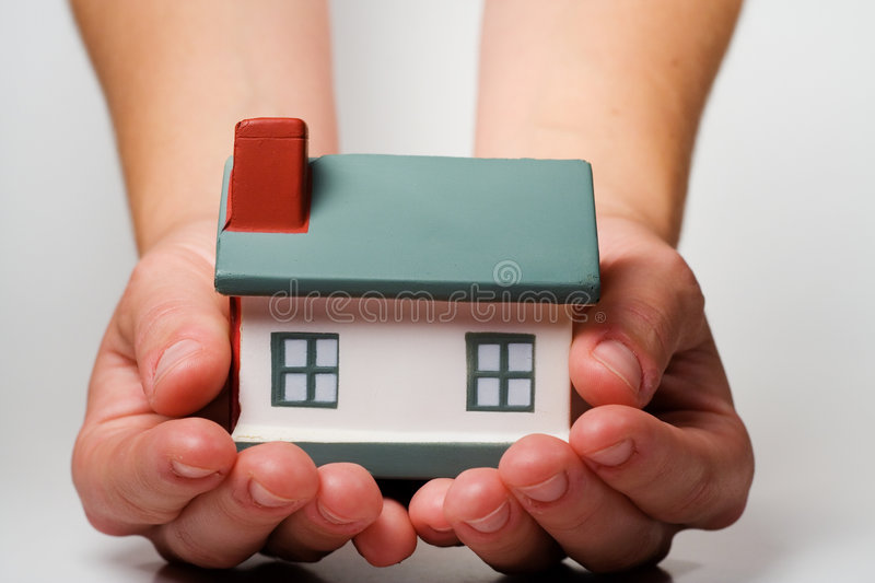 Home in Hands stock photography
