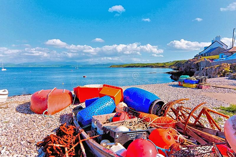 Home Harbour at Moelfre Beach Anglesey North Wales. On a warm Spring Day.  Moelfre is a small community and former Fishing Port.  In an area of Archaeological royalty free stock images