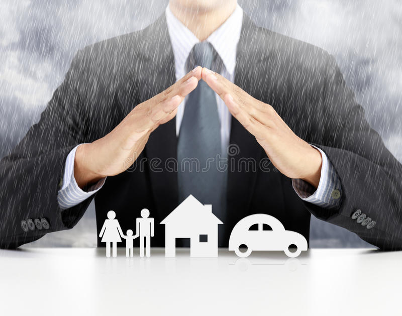 Home, health, car, insurance concept. With businessman stock image