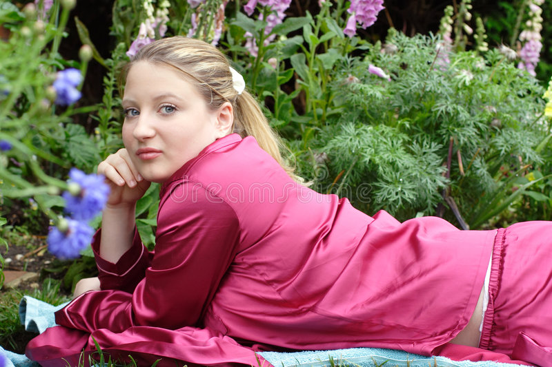 At home in her garden. stock image