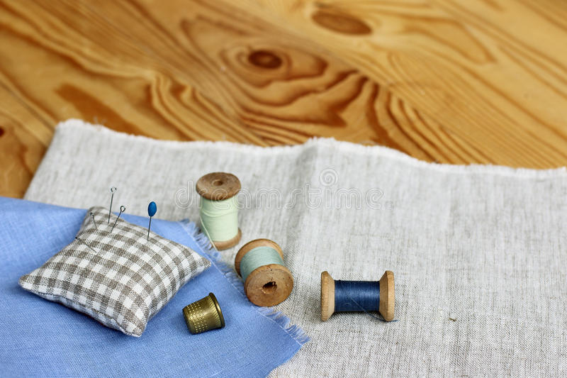 Home hobby crafts. Homemade crafts hobby with thimble and thread royalty free stock photos
