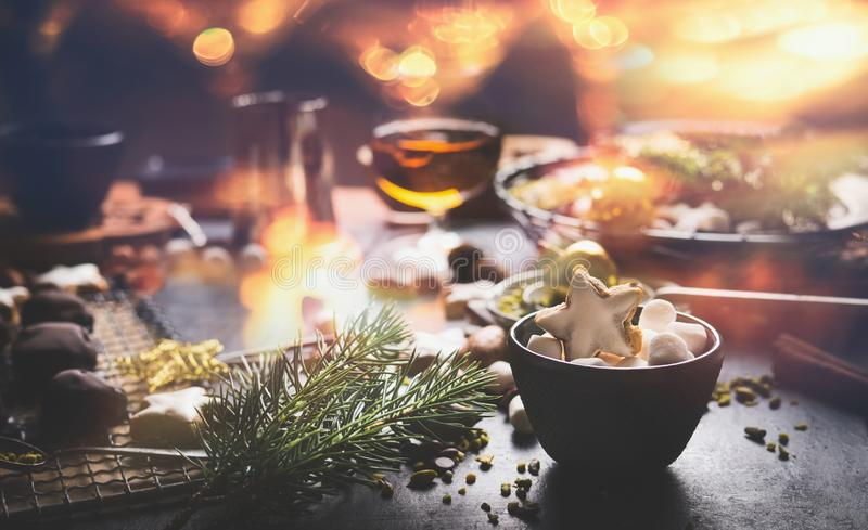 Home holidays cuisine and sweet gifts making for Christmas. Mug with marshmallows and cinnamon star Christmas cookie on table royalty free stock photo