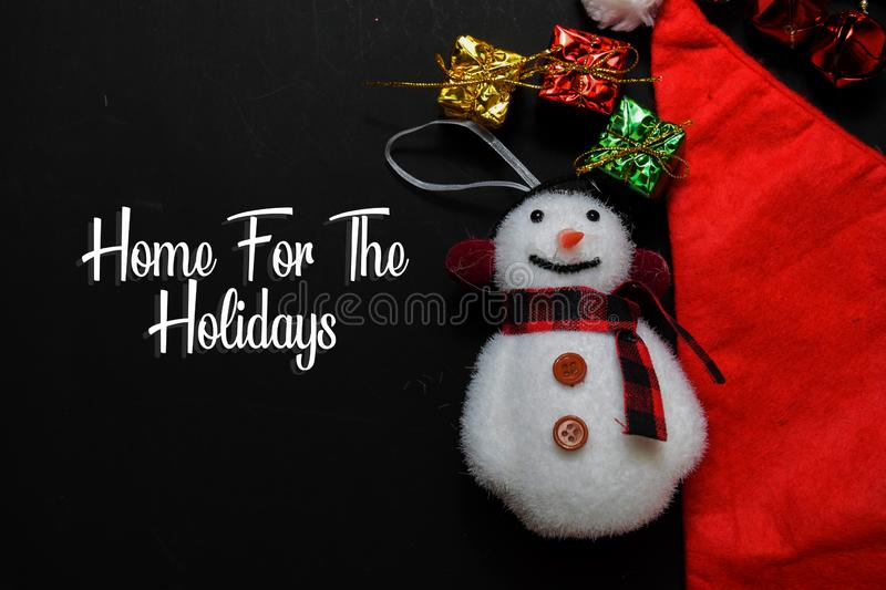 Home For The Holidays text isolated on black backgroud. Frame of Christmas Decoration stock images
