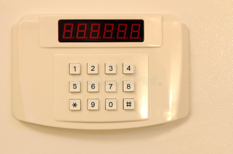 Home or hotel wall safe with keypad. Small home or hotel wall safe with keypad, closed door royalty free stock images