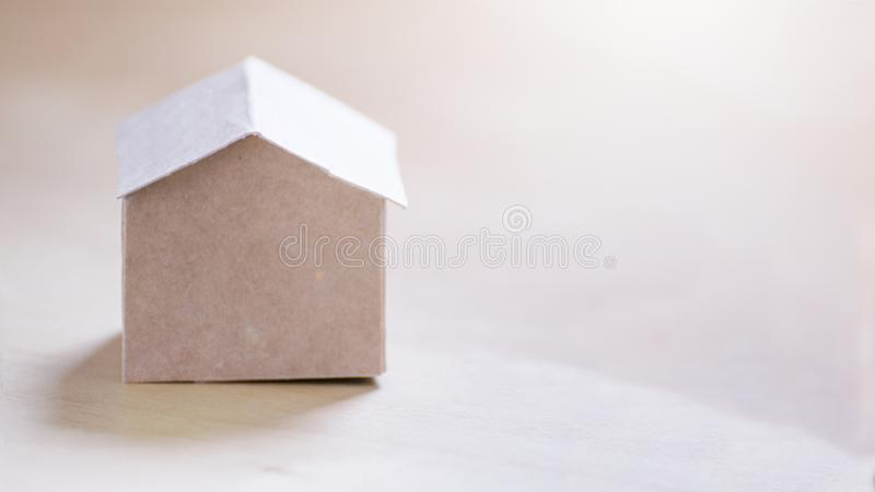 Home or house icon made of cardboard and empty copy space for Editor`s text. Recycling at home. Concept royalty free stock photography