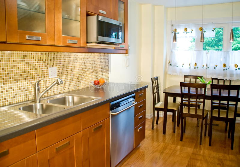 kitchen in luxury home with oak cabinets stock photo   Modern Home Kitchen, Stove, Oak Cabinets Interior Stock ...