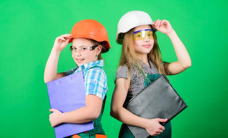 Home improvement activities. Builder engineer architect. Future profession. Kids girls planning renovation. Initiative. Children girls provide renovation their stock photo