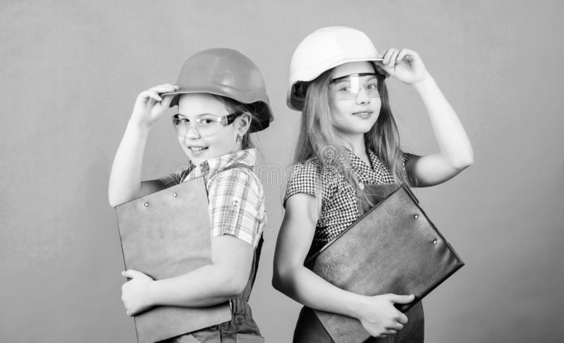 Home improvement activities. Builder engineer architect. Future profession. Kids girls planning renovation. Initiative. Children girls provide renovation their royalty free stock photo