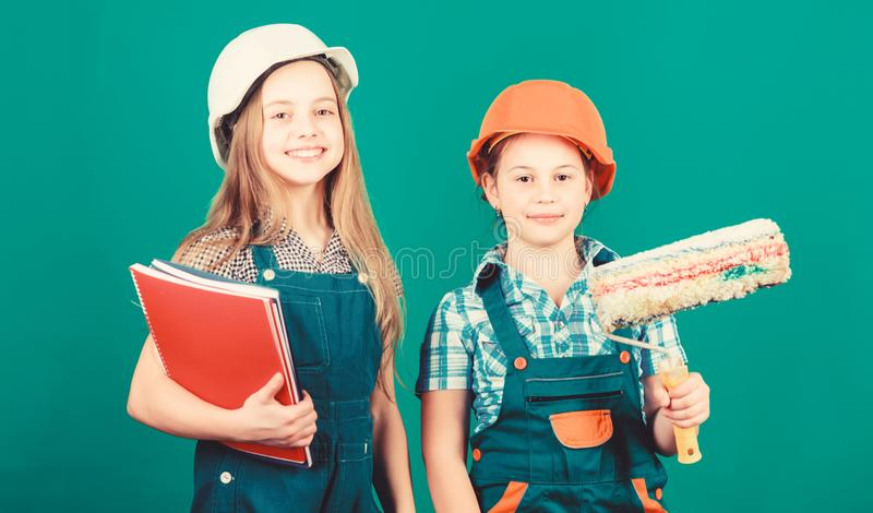 Home improvement activities. Future profession. Kids girls planning renovation. Initiative children provide renovation. Their room green background. Amateur stock photography