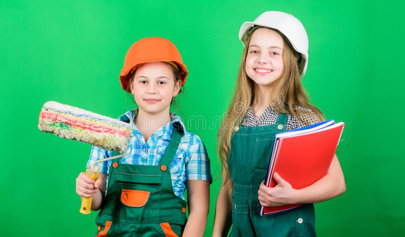 Home improvement activities. Future profession. Kids girls planning renovation. Initiative children provide renovation. Their room green background. Amateur royalty free stock image