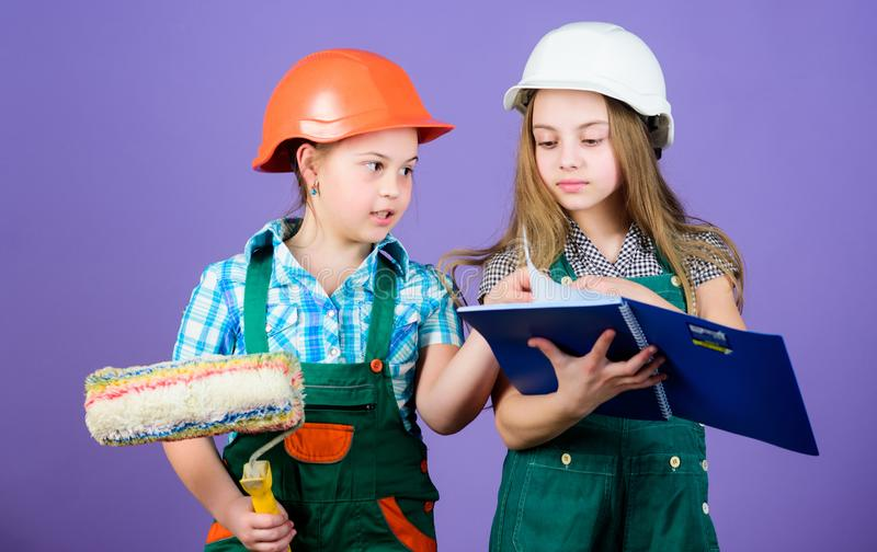 Home improvement activities. Kids choosing paint colour for their new room. Kids girls planning renovation. Children. Sisters run renovation their room. Amateur stock photo