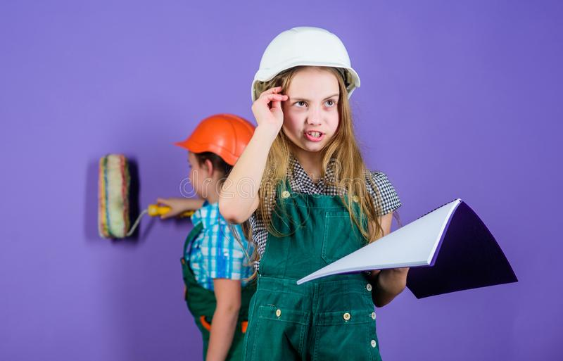 Home improvement activity. Kids girls planning renovation. Repaint walls. Move in new apartment. Children sisters run. Renovation their room. Control renovation royalty free stock photo
