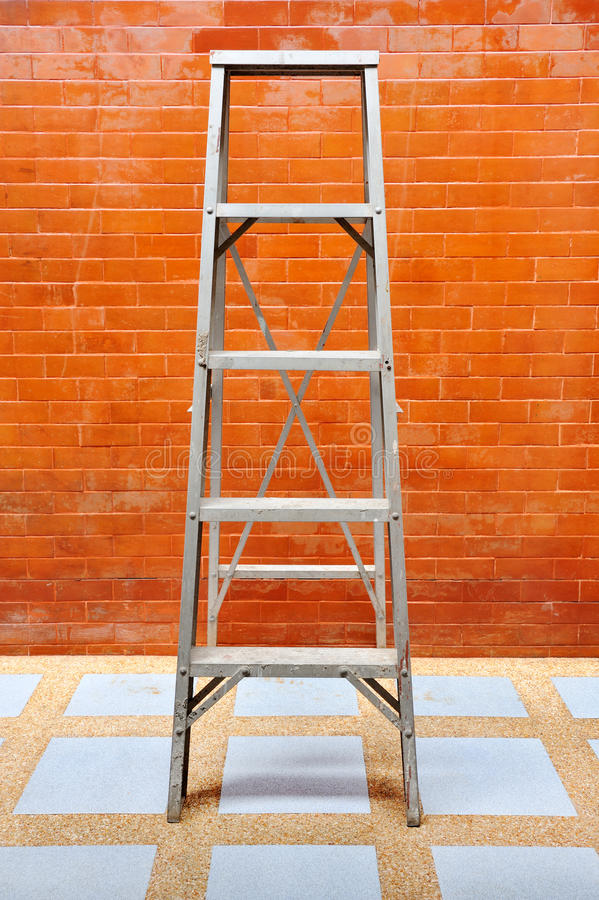 Download Home Improvement Concept With Ladder And Brick Wall Stock Photo - Image: 33616940