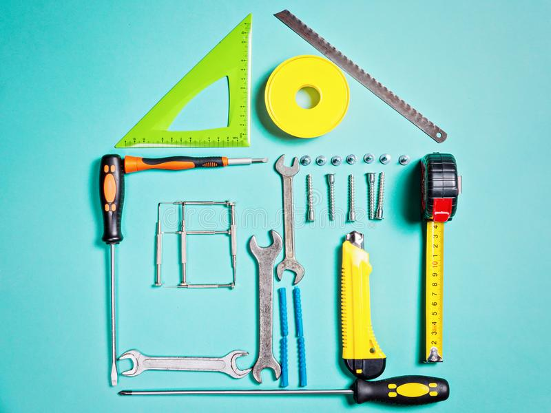 Home improvement concept. Set work hand tool for construction or repair of house. Rebuilding DIY. Group of tools in shape house stock image
