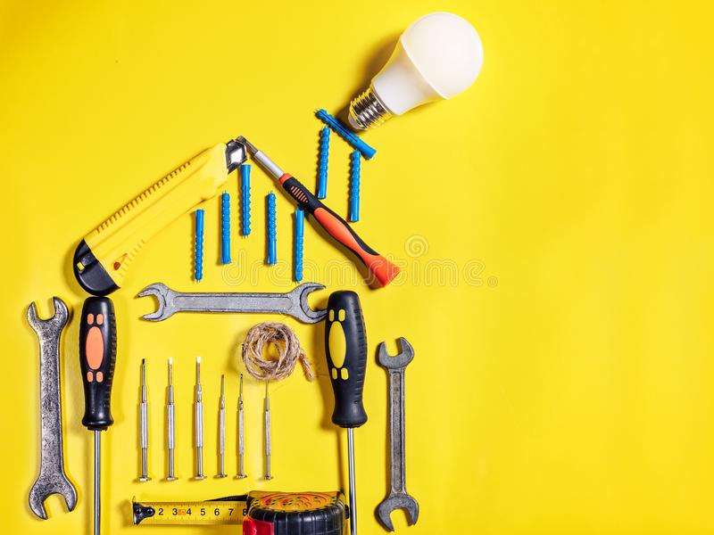 Home improvement concept. Set work hand tool for construction or repair of house. Rebuilding DIY. Group of tools in shape house. Idea conservation of energy stock photography