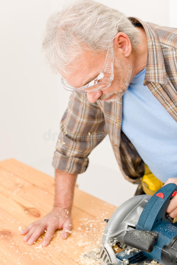 Free Home Improvement - Handyman Cut Wood With Jigsaw Stock Photos - 17770043