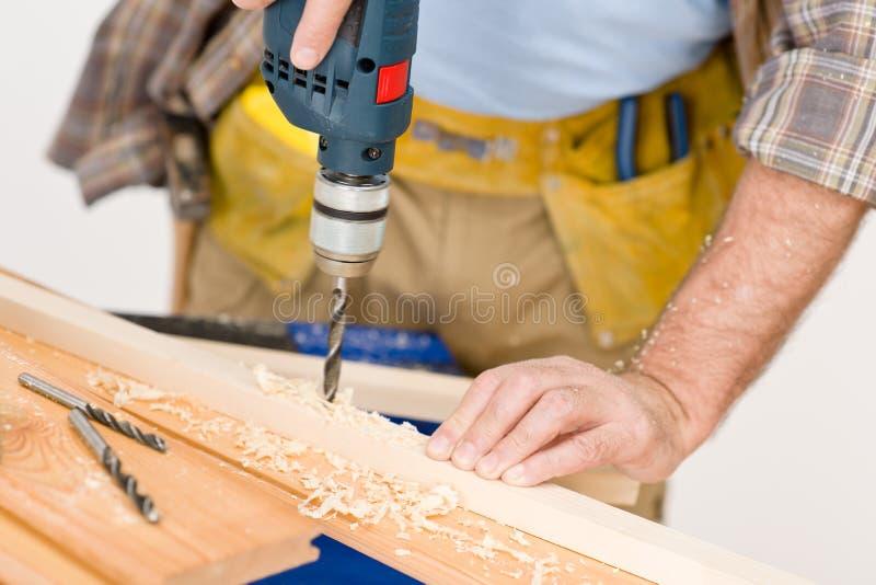 Home improvement - handyman drilling wood royalty free stock image